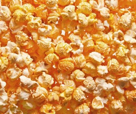 Pile of fresh popcorn filling the frame against bright light photo