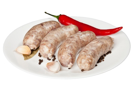 veal sausage: The hunting sausages on a white plate is isolated on the white background
