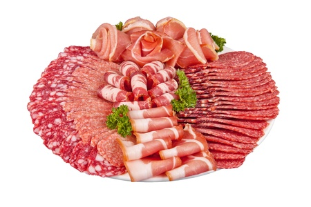 raw ham: salami ham meat and more on the plate isolated on the white background