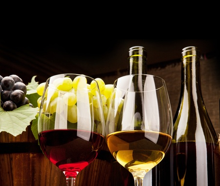 fruit drinks: Still life with wine bottles, glasses and grapes Stock Photo