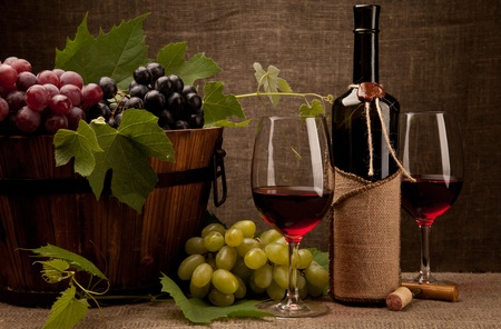 Still life with wine bottles, glasses and grapes Stock Photo - 10617503