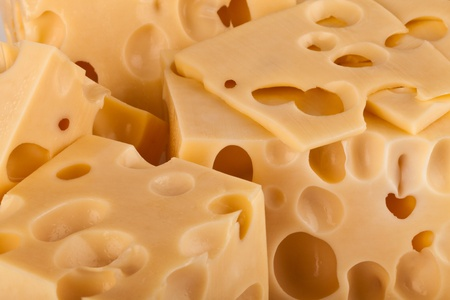 cheez: Background of fresh yellow Swiss cheese with holes Stock Photo