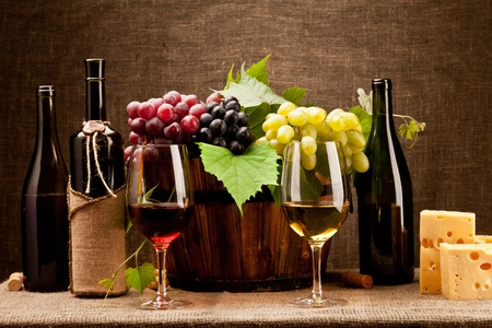 still life of wine: Still life with wine bottles, glasses and grapes Stock Photo