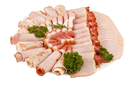 salami ham meat and more on the plate isolated on the white background photo