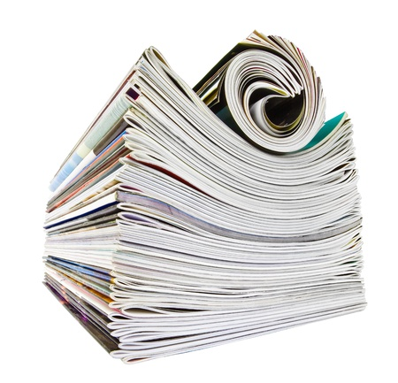 Various stacked and rolled magazines over white Stock Photo - 11620824