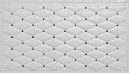 Clean Simple White Tile Wall Background with golden detailing photo