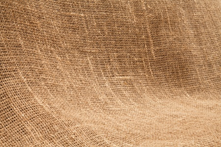 sack cloth: Close-up of natural burlap hessian sacking. Background texture using burlap material. Stock Photo