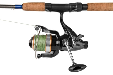 Fishing rod and reel isolated on the white background with clipping path photo