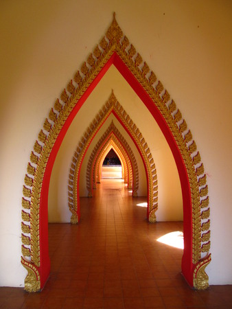 door casing: Attractive arches of a temple in Thailand Stock Photo