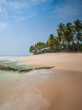 Greate and beautiful place in paradise. Indian ocean with golden sand and palm in Sri Lanka.