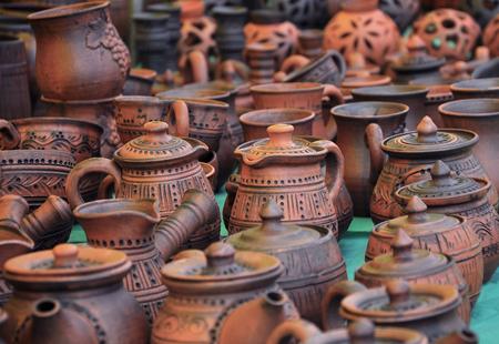 loamy: Handmade traditional russian ceramics (crockery, things, ware, jugs, pots) on the shopboard