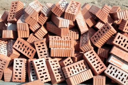 Heap of red ceramic hollow bricks