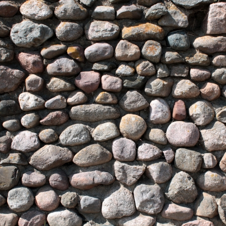 armour plating: Wall of big stones background Stock Photo