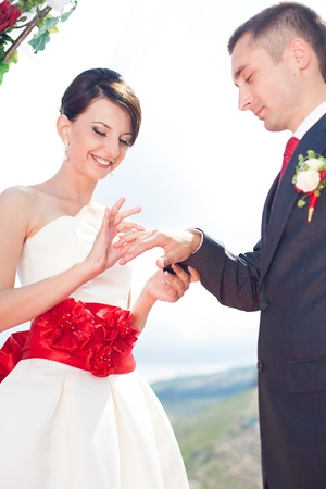 manhood: A young couple in love bride and groom with a bouquet, wedding day in summer. Enjoy a moment of happiness and love.