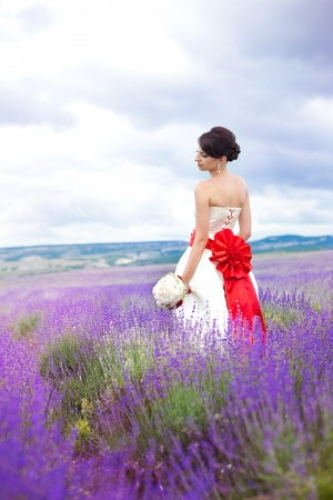 Happy young bride in a lavender field. Wedding day. A series of photos in my portfolio. photo