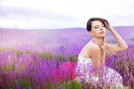 Happy young bride in a lavender field. Wedding day. A series of photos in my portfolio. Stock Photo - 16270621