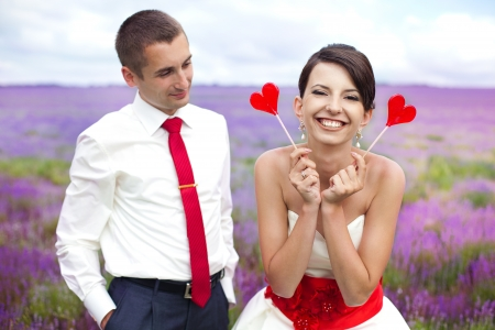 happy young couple in a lavender field  wedding day photo