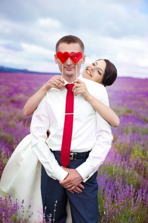 happy young couple in a lavender field  wedding day