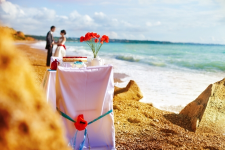 wedding chairs: Fantastic dinner sweets near the sea on wedding day  Decoration of table
