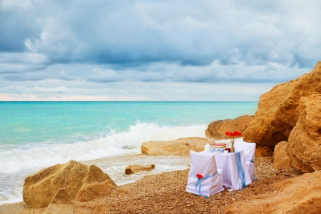 Fantastic dinner sweets near the sea on wedding day  Decoration of table  Stock Photo - 16291621