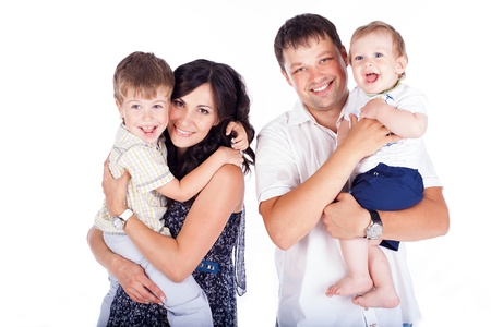 Happy family father and mother with children posing in the studio on a white background  A series of photos in my portfolio  Stock Photo