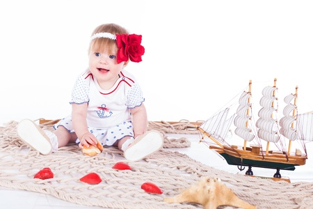 small beautiful child playing in studio on a white background Stock Photo - 16302454