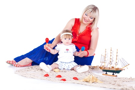 Young beautiful family Mum and little daughter posing in the studio on a white background  Stock Photo - 16302462