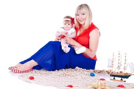 Young beautiful family Mum and little daughter posing in the studio on a white background Stock Photo - 16302460