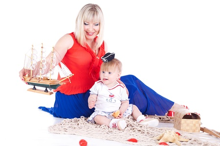 Young beautiful family Mum and little daughter posing in the studio on a white background  Stock Photo - 16302426