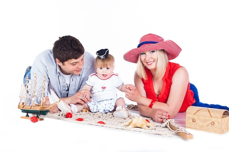 Young beautiful family of 3 persons Mum, Dad and little daughter posing in the studio on a white background Stock Photo - 16302431