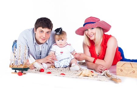 3 persons: Young beautiful family of 3 persons Mum, Dad and little daughter posing in the studio on a white background