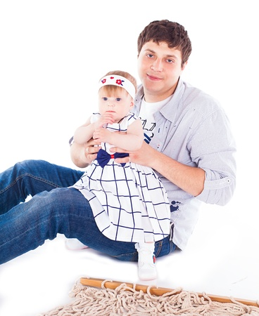 Young beautiful family Dad and little daughter posing in the studio on a white background  Stock Photo - 16302436