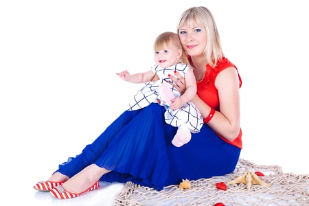 Young beautiful family Mum and little daughter posing in the studio on a white background Stock Photo - 16302465