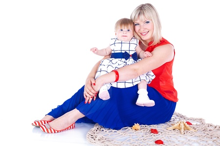 Young beautiful family Mum and little daughter posing in the studio on a white background  Stock Photo - 16302459