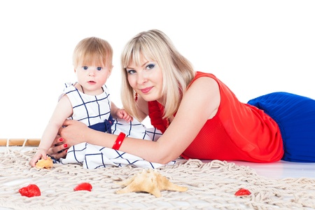 Young beautiful family Mum and little daughter posing in the studio on a white background Stock Photo - 16302464