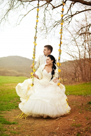 A beautiful pair of bride and groom posing in the park  Stylized Wedding in oranges  Stock Photo