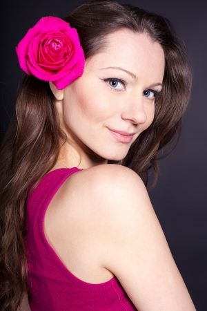 Beautiful young girl with a flower in her hair  studio shot Stock Photo - 16306412
