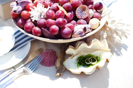 Fantastic dinner near the sea on wedding day  Decoration of table  photo