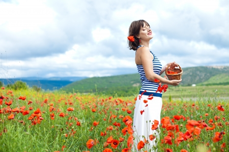 beautiful girl in a field of poppies photo