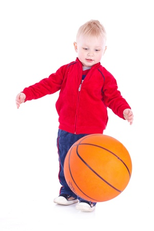 A little boy playing with a basketball  Studio shot on a white background  photo