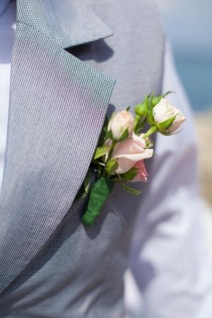 buttonhole: boutonniere on groom s suit