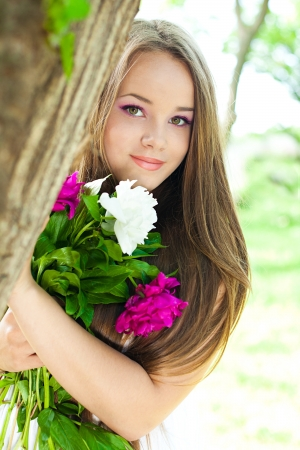 Portrait of young woman with flowers  Series Stock Photo