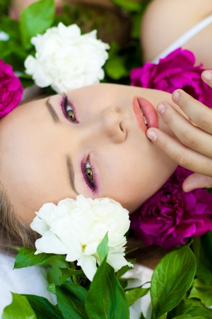 Portrait of young woman with flowers photo