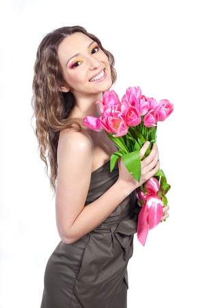 Beautiful young girl with a bouquet of flowers  isolated  Studio