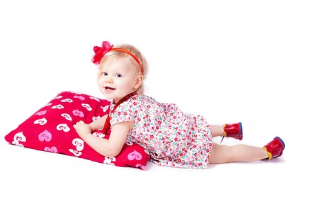 stodio: Lovely baby play with a large pillow  Stodio shot  isolated