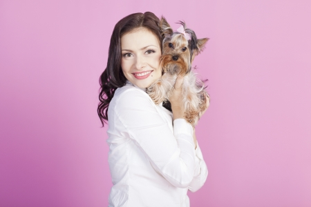 Young brunette with a dog photo