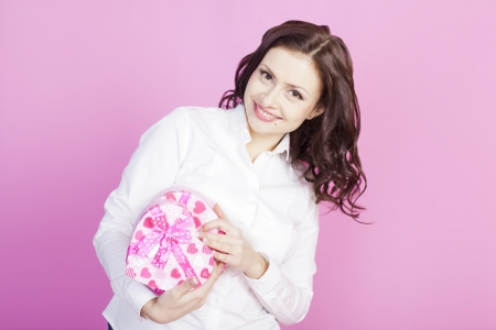 young brunette was presented with a box of chocolates photo