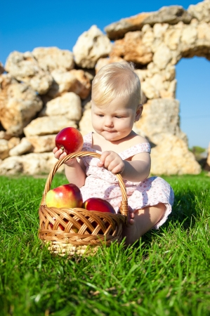 The child, a basket of apples Stock Photo - 16583114