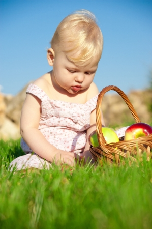 The child, a basket of apples Stock Photo - 16583106