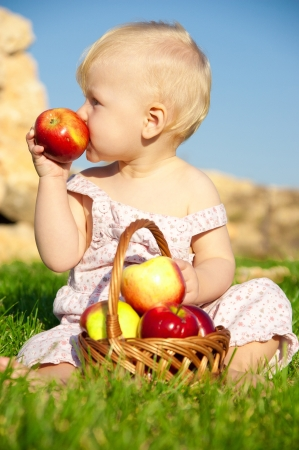 The child, a basket of apples Stock Photo
